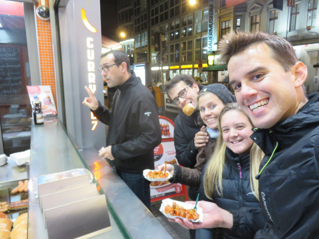 About to tuck into a never-before-eaten Currywurst with extended family in Berlin, Germany.